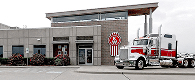 MHC Kenworth Storefront with Kenworth Bug Logo and W900 Truck