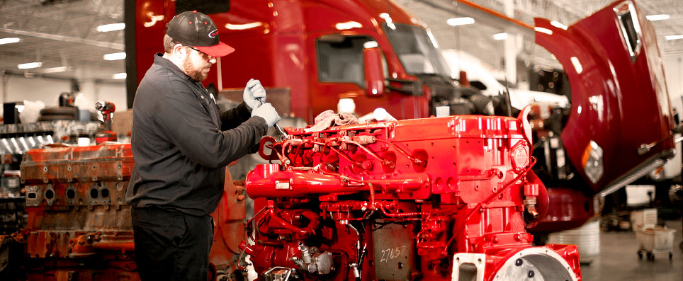 MHC Kenworth Service Technician Working on a Cummins Engine Overhaul